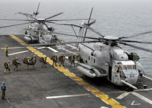 U.S. Marines attached to Battalion Landing Team 2/2 board a CH-53E Super Stallion helicopter aboard amphibious assault ship USS Bataan (LHD 5) April 2, 2007, in the Persian Gulf. The Marines are headed to Qatar to participate in exercise Eastern Maverick. The helicopter belongs to Medium Marine Helicopter Squadron 264 (Reinforced). DoD photo by Mass Communication Specialist 1st Class Ken J. Riley, U.S. Navy. (Released)